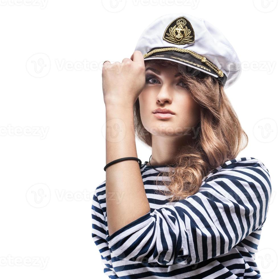 Young Beautiful Adorable Woman in sea peak-cap and stripped vest photo