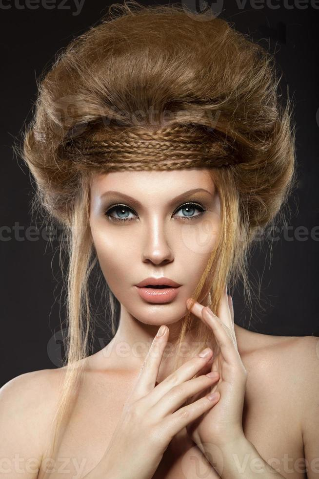 Beautiful red-haired girl with perfect skin and an unusual hairstyle. photo