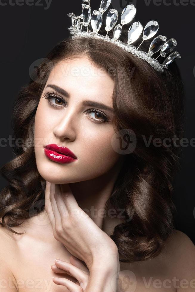 Beautiful girl with a crown in the form of princess. photo