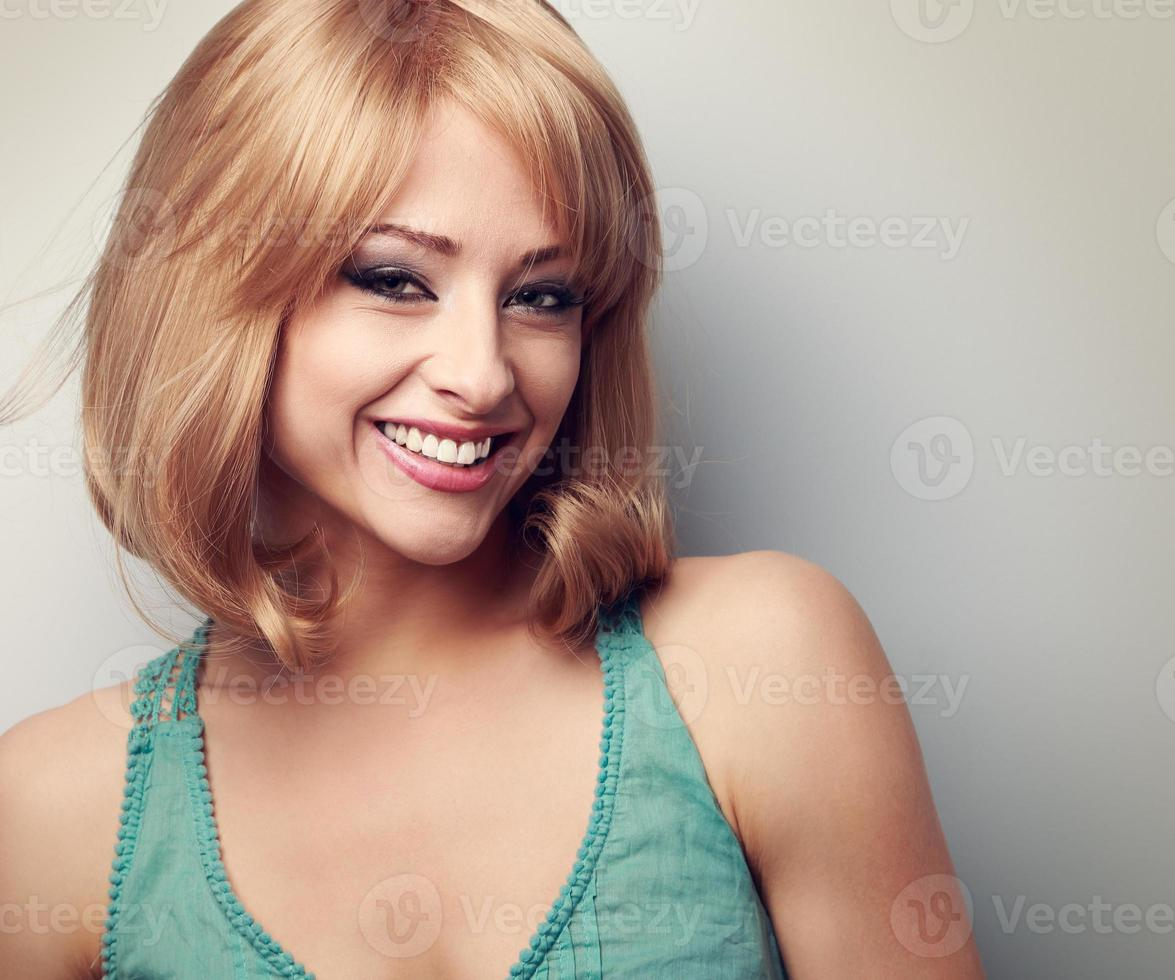 Happy laughing blond woman with short hair style. Closeup toned photo