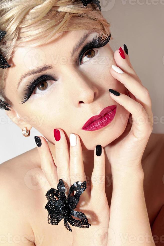Makeup and manicure with red . photo