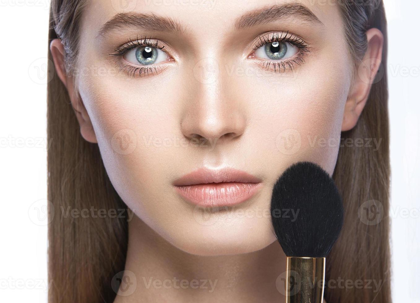 Beautiful young girl with a light natural make-up and photo