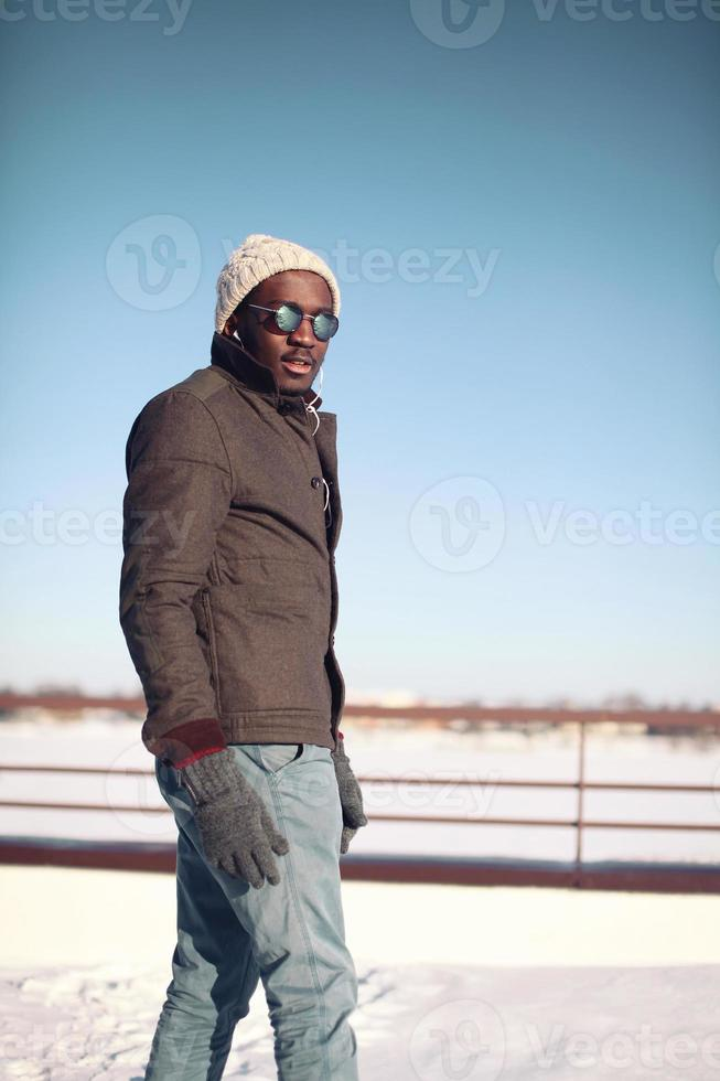 Fashion, clothes and people concept - stylish young african man photo