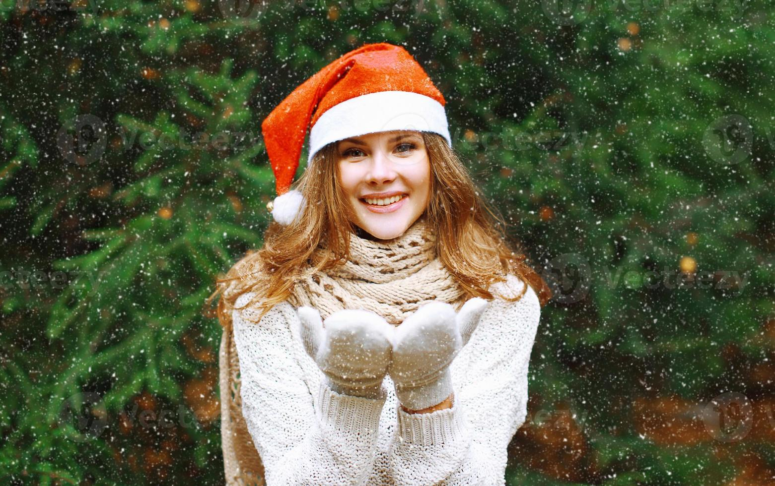 Christmas and people concept - happy young girl photo