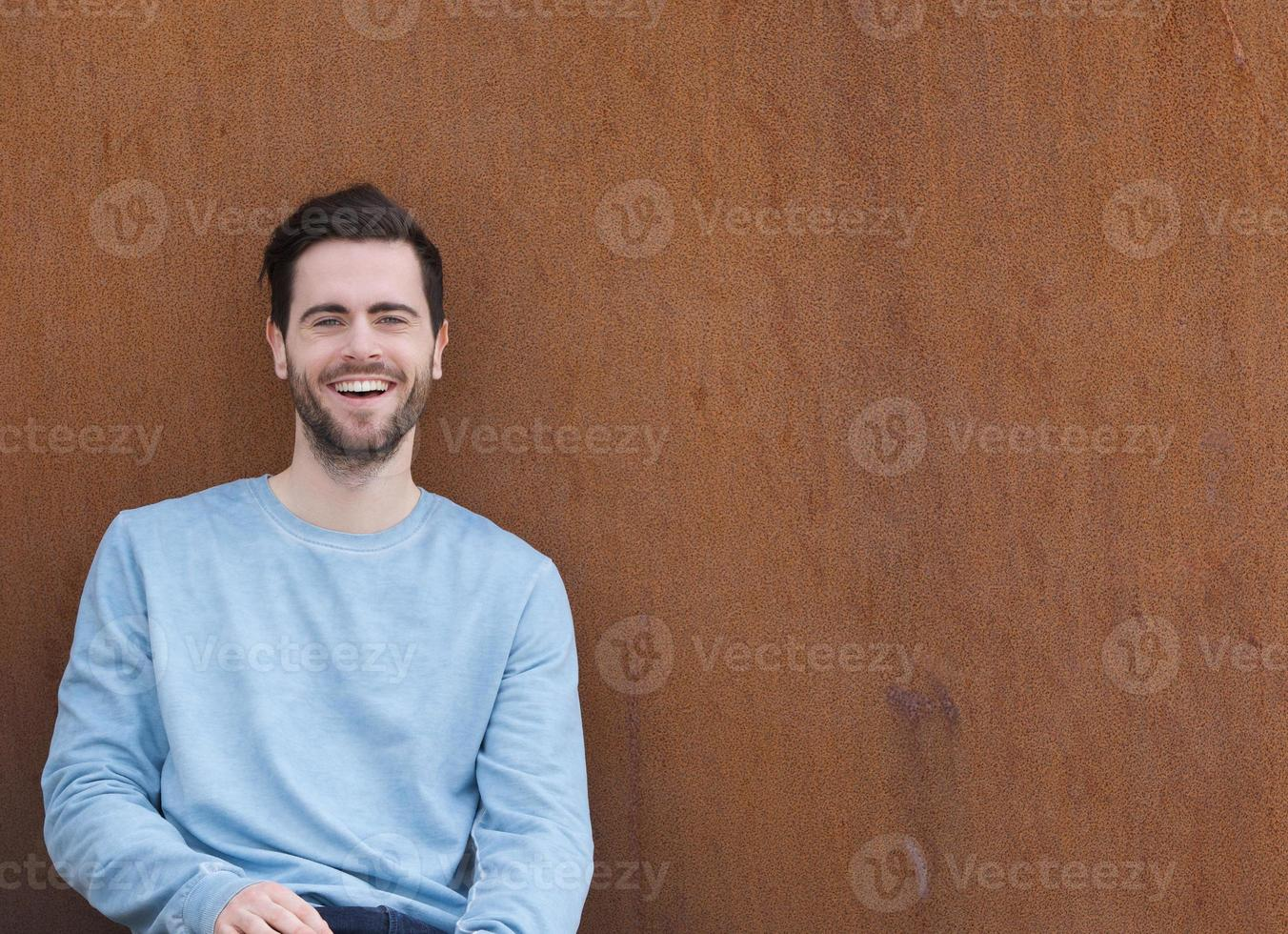 Handsome young man laughing photo