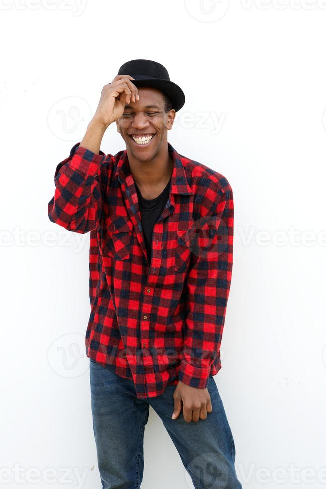 Trendy young man laughing photo