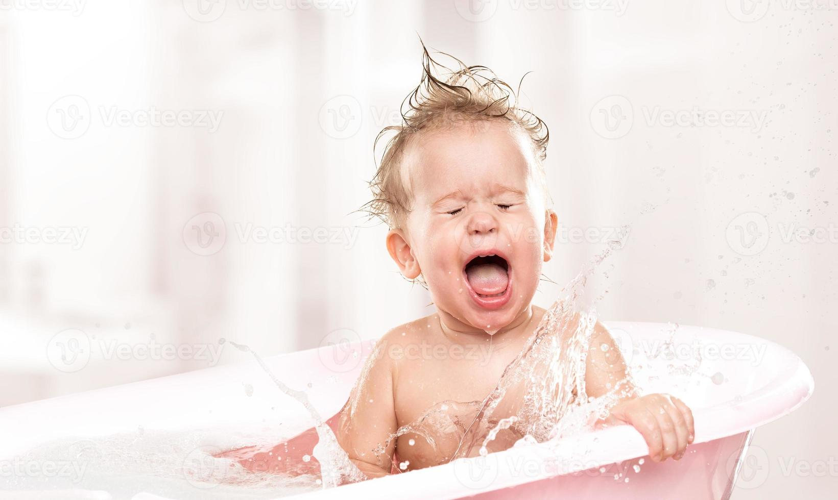 happy funny  baby  laughing and bathed in bath photo
