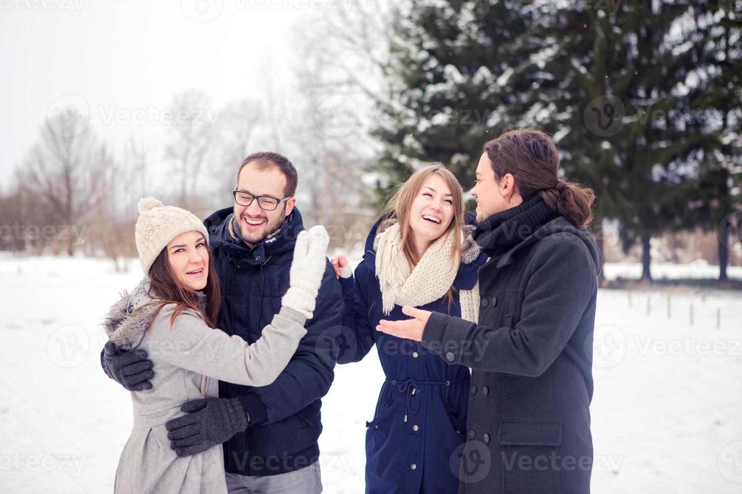 Friends having fun on snow photo