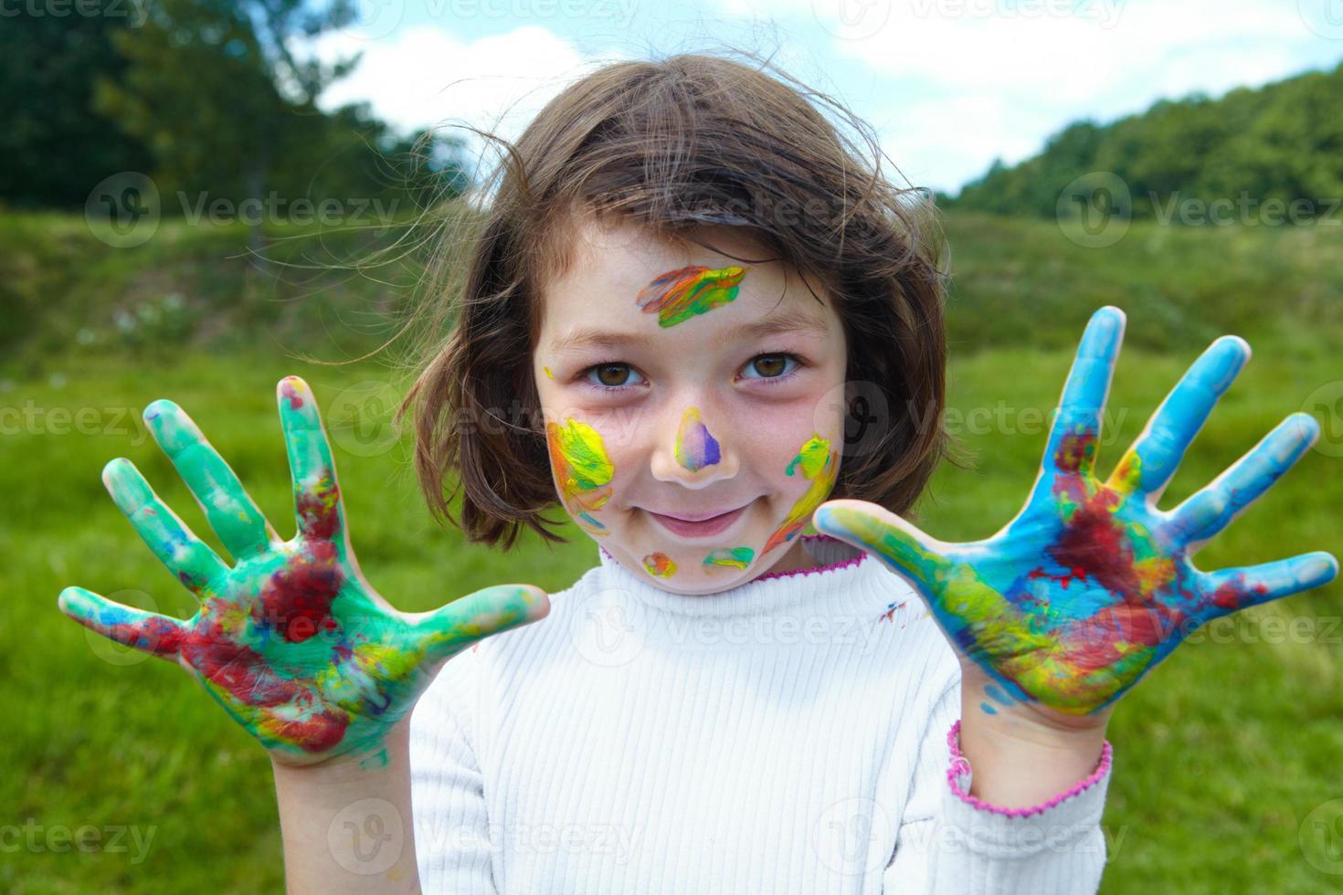 Little girl draws paints photo