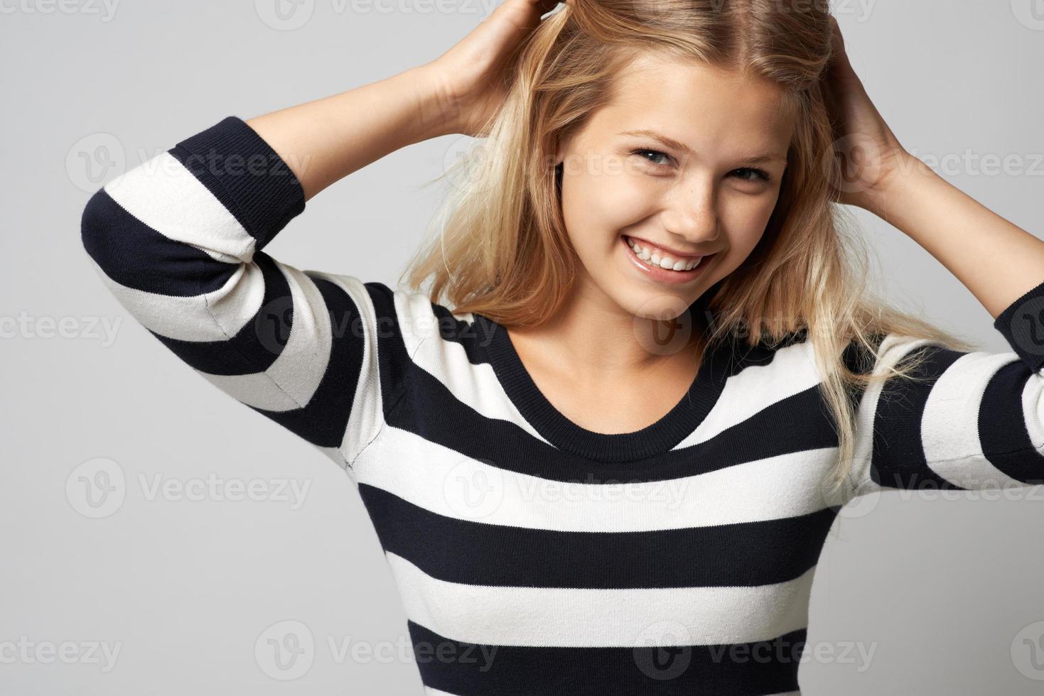 beautiful girl in a striped sweater cute smiling photo