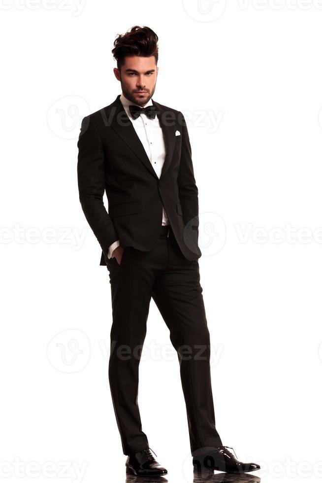 relaxed elegant man in tuxedo photo