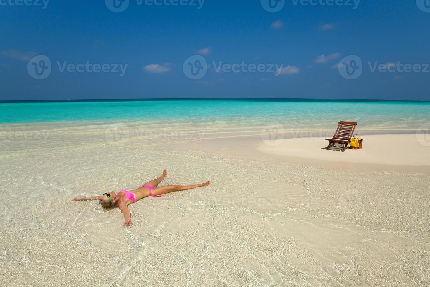 Cute woman relaxing on the tropical beach photo