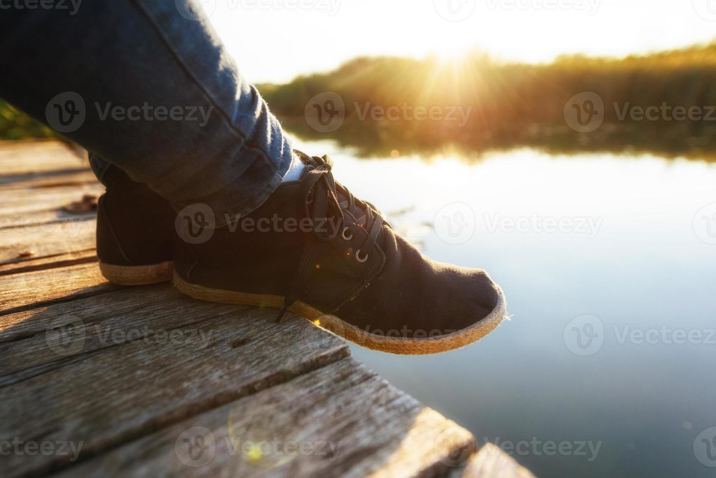 Woman relaxing on jetty photo