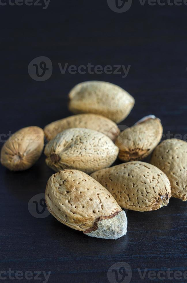 Unpeeled almonds close up photo