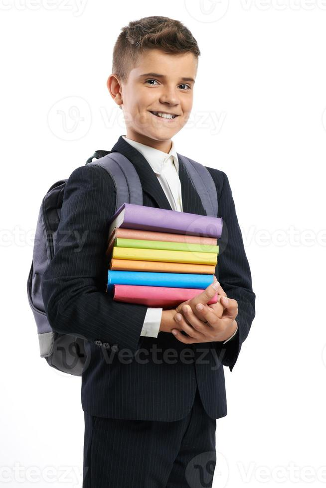 student shows stack of textbooks photo