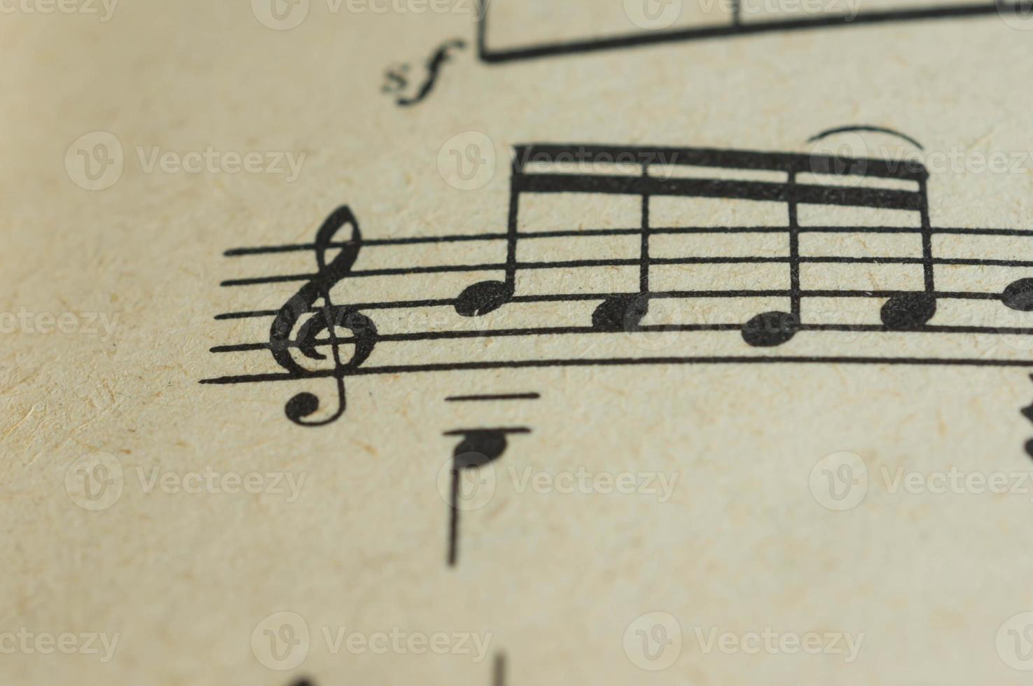 Treble clef and some notes close up on the page photo