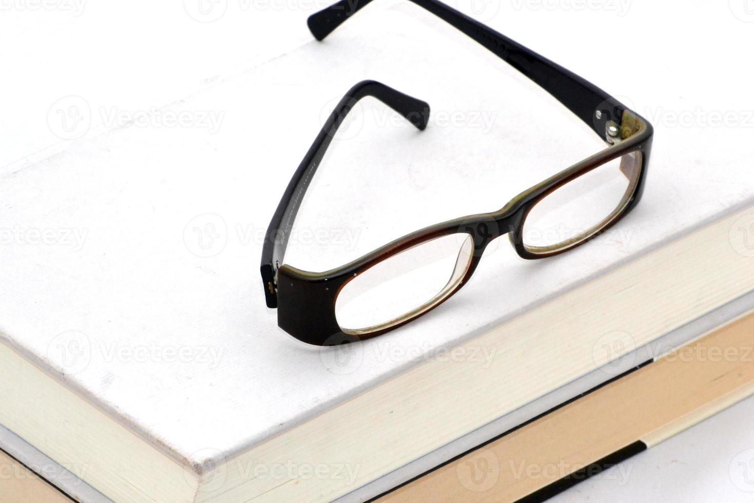 libros y anteojos foto