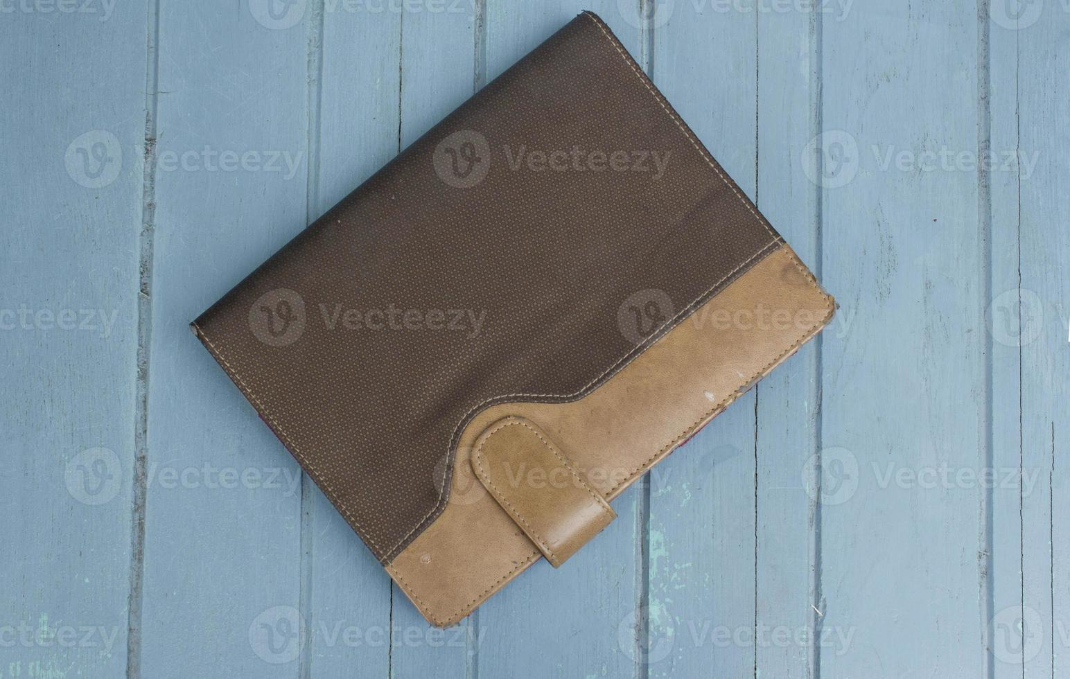 hardcover book on wood background photo
