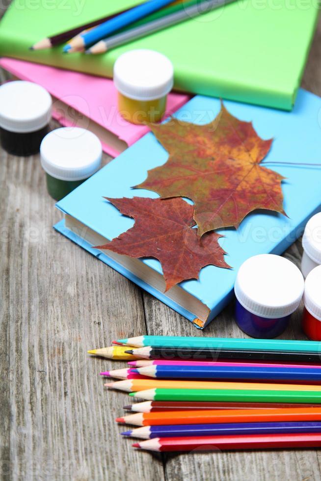 Books, pencils and maple leaf photo