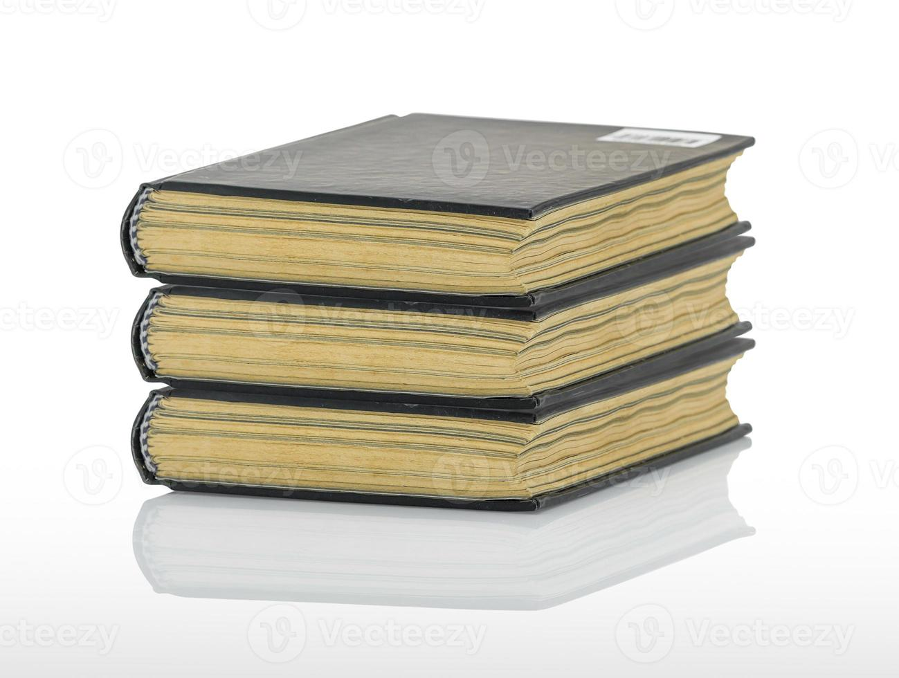 Closed black book with shadow on white background photo