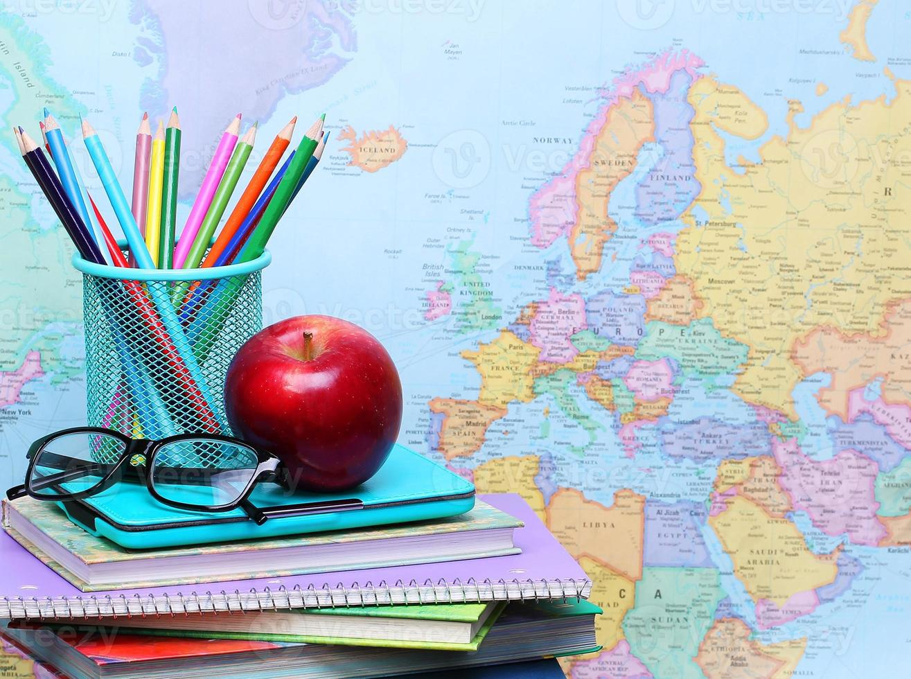 Back to school. An apple, pencils and glasses photo