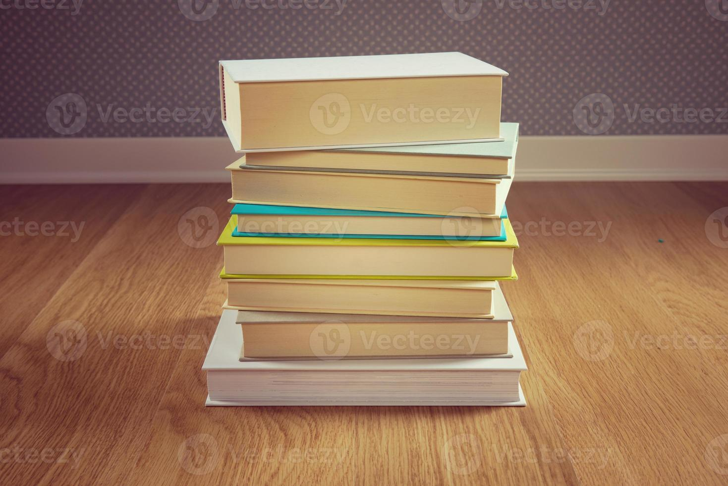 Stack of books on the floor photo