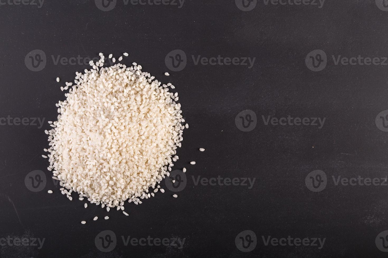 Rice on black chalkboard photo