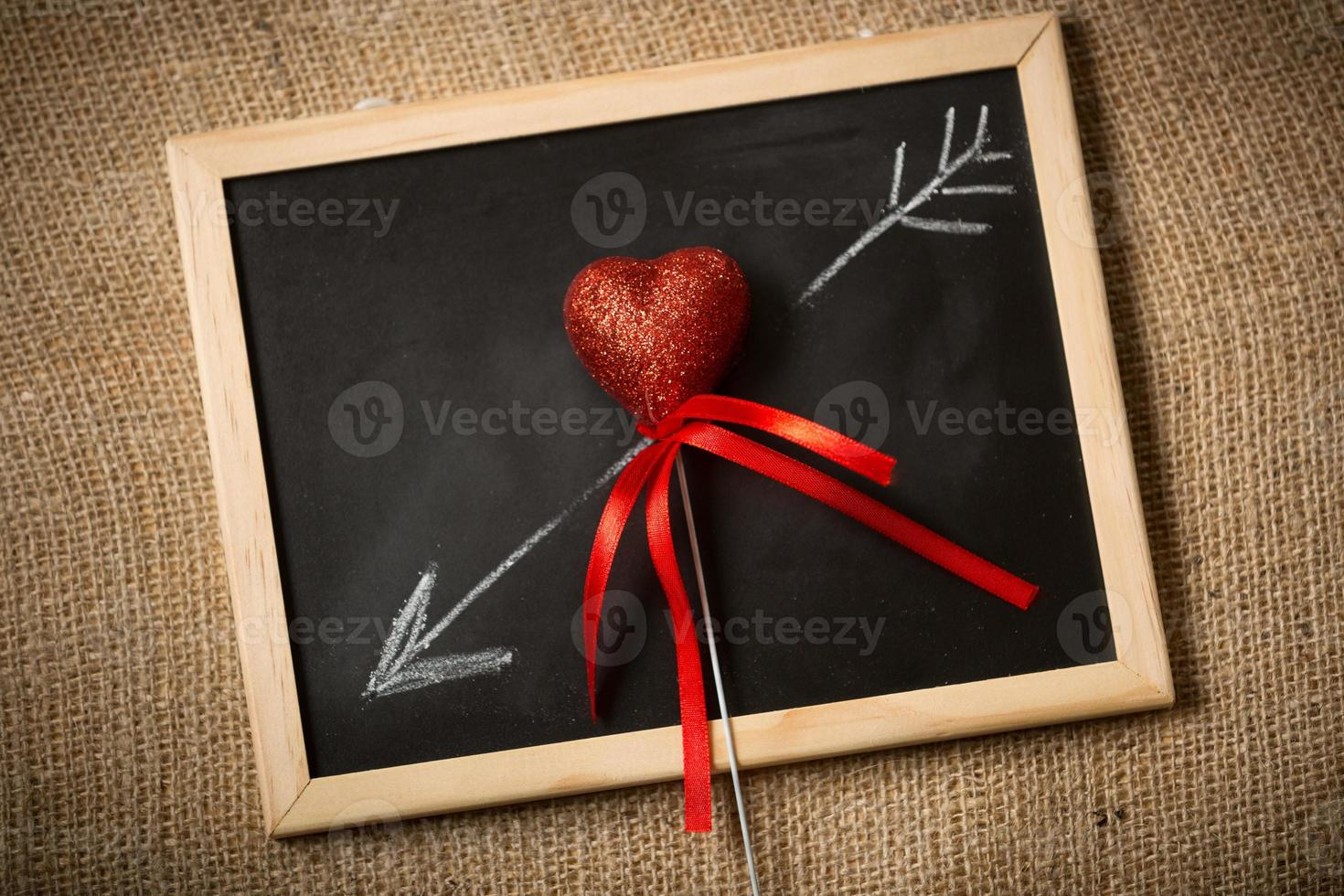 drawn on chalkboard arrow going through decorative heart photo