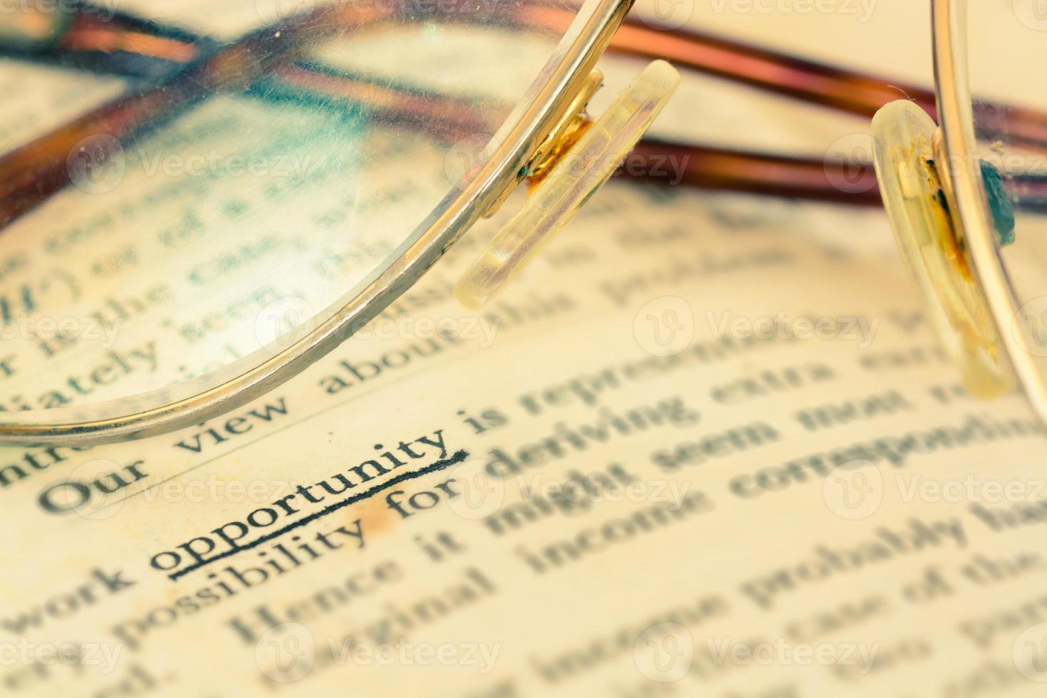 Focus opportunity word in vintage text book photo