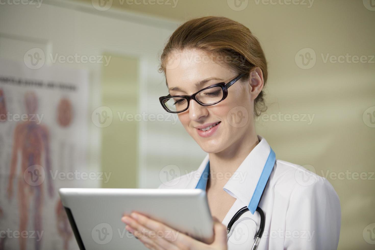 Young beautiful woman doctor photo