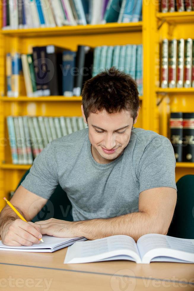Man studying photo