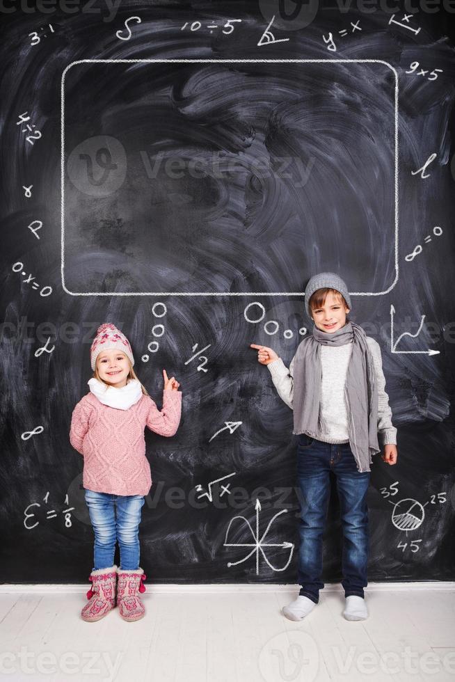 Boy and girl studying math photo