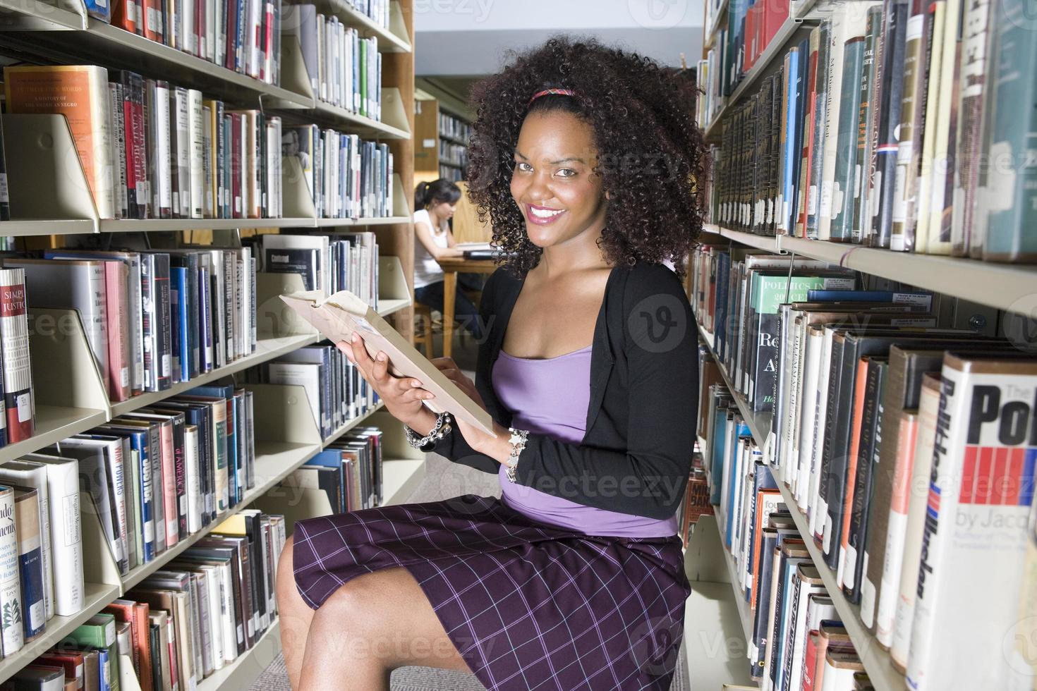 Female university student studying in library, portrait photo
