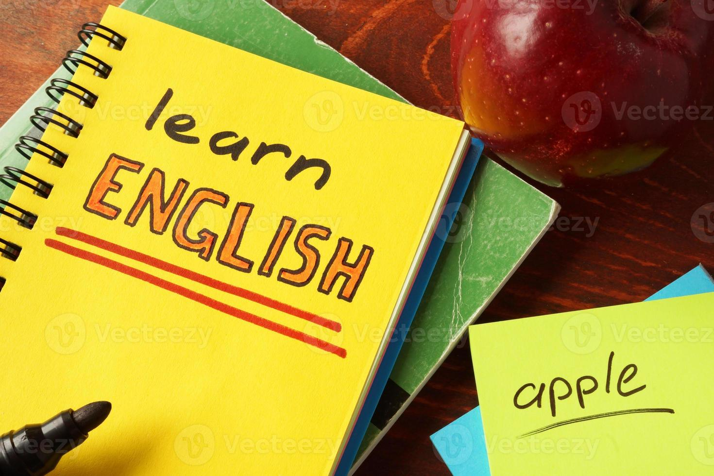 Notebook with learn English sign. photo