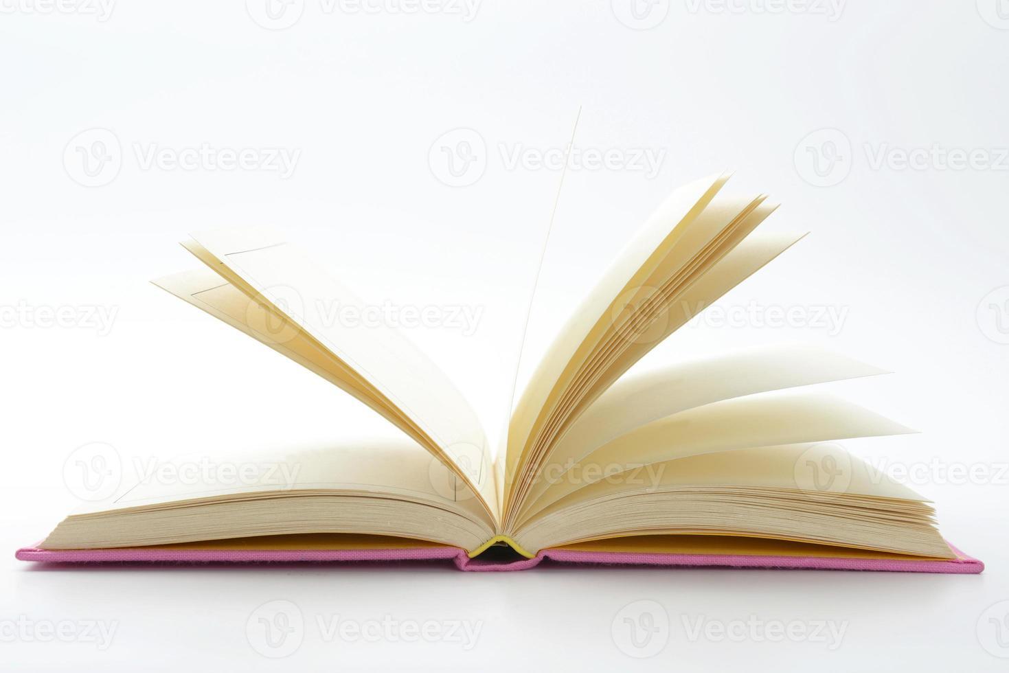 Opened book on white background photo