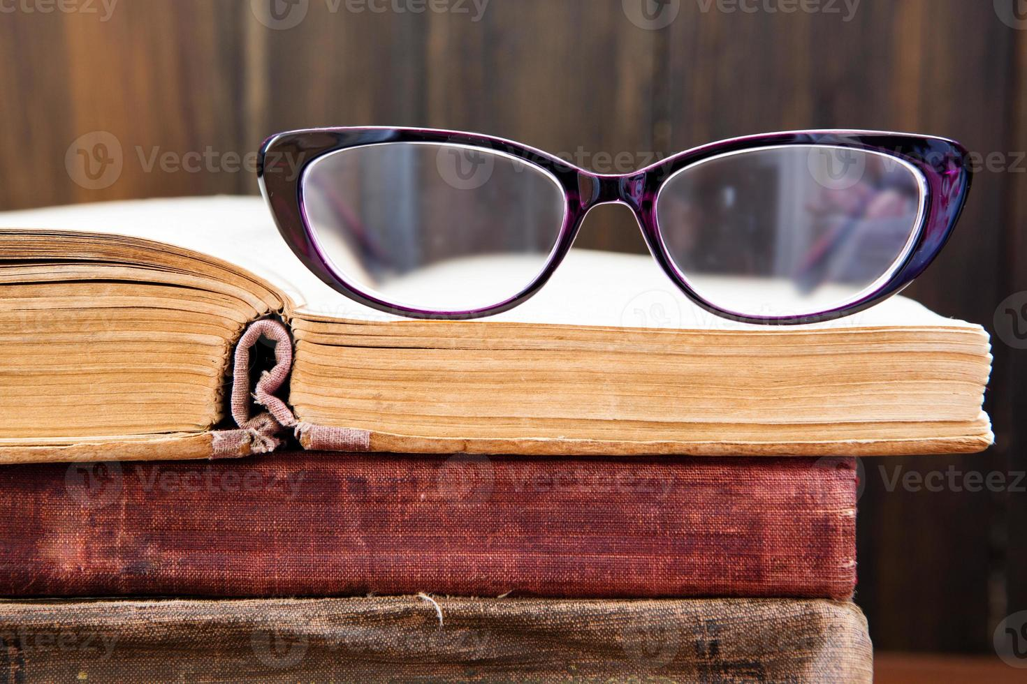 Vintage reading glasses on the book photo