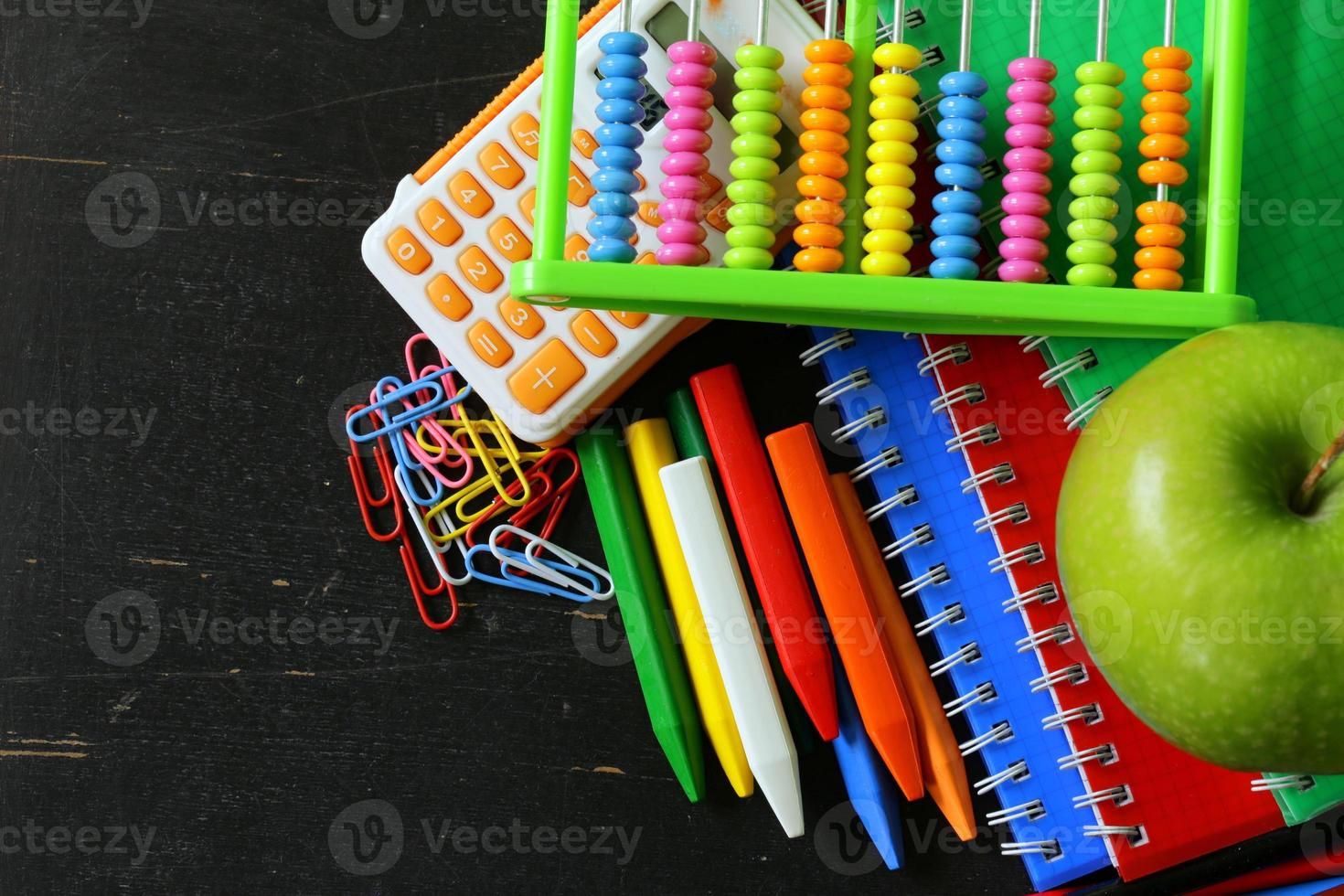 Back to school concept, school stationery multicolored pencils and notebooks photo