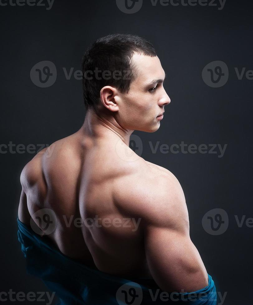 Muscled male model showing his back photo