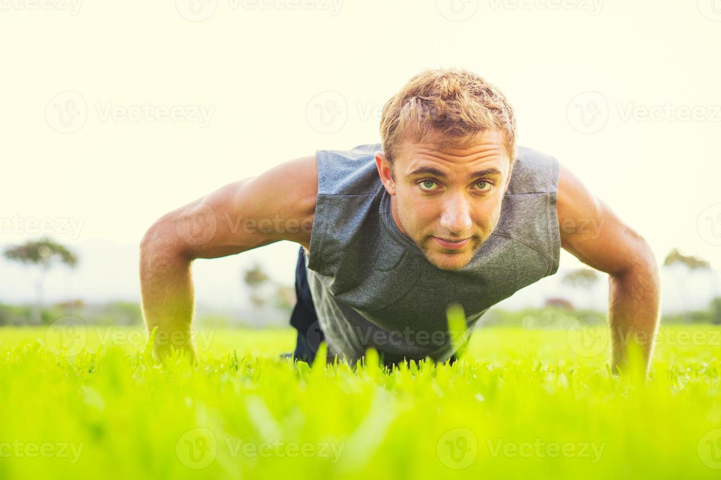 Man doing push up photo