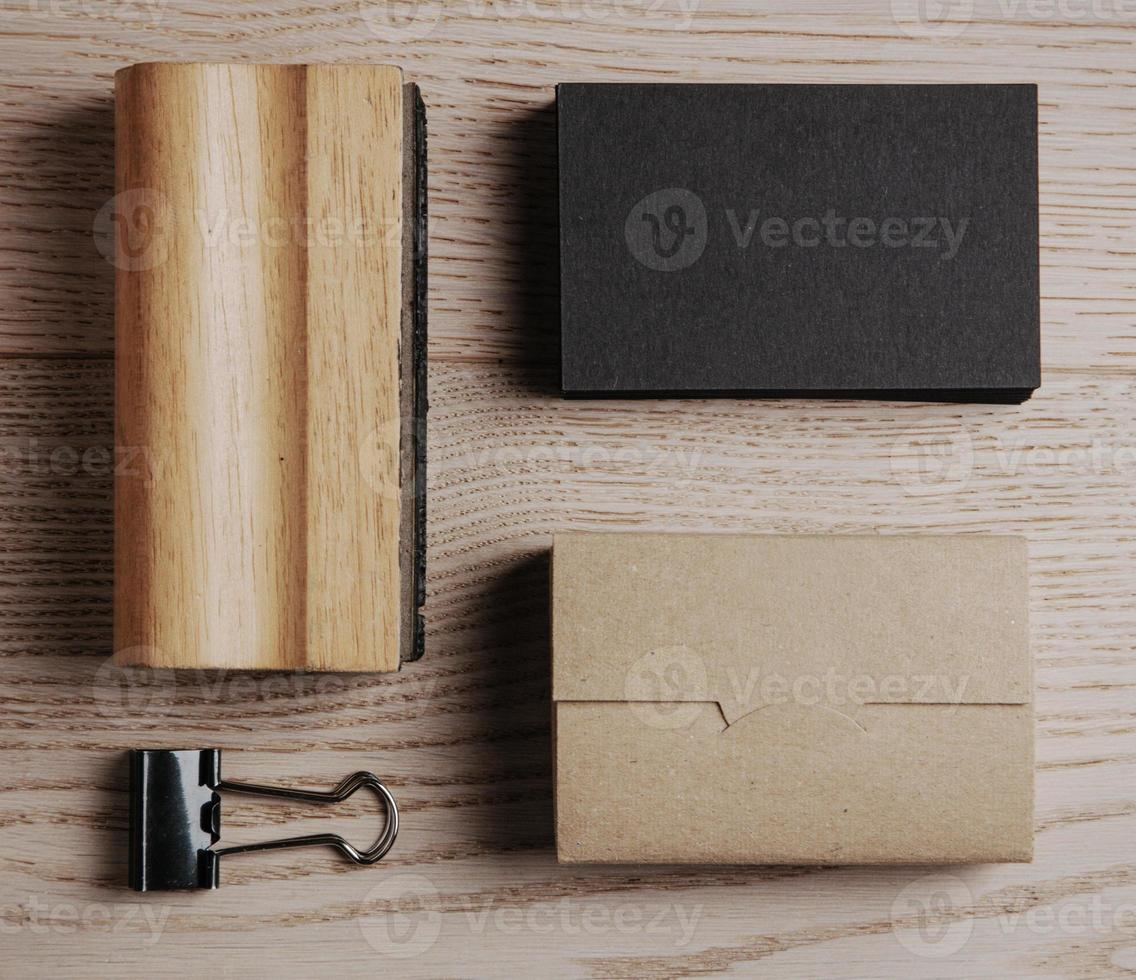 Top view of classic office elements on the wooden background photo