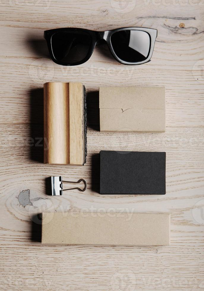 Set of branding business elements on the wooden background photo