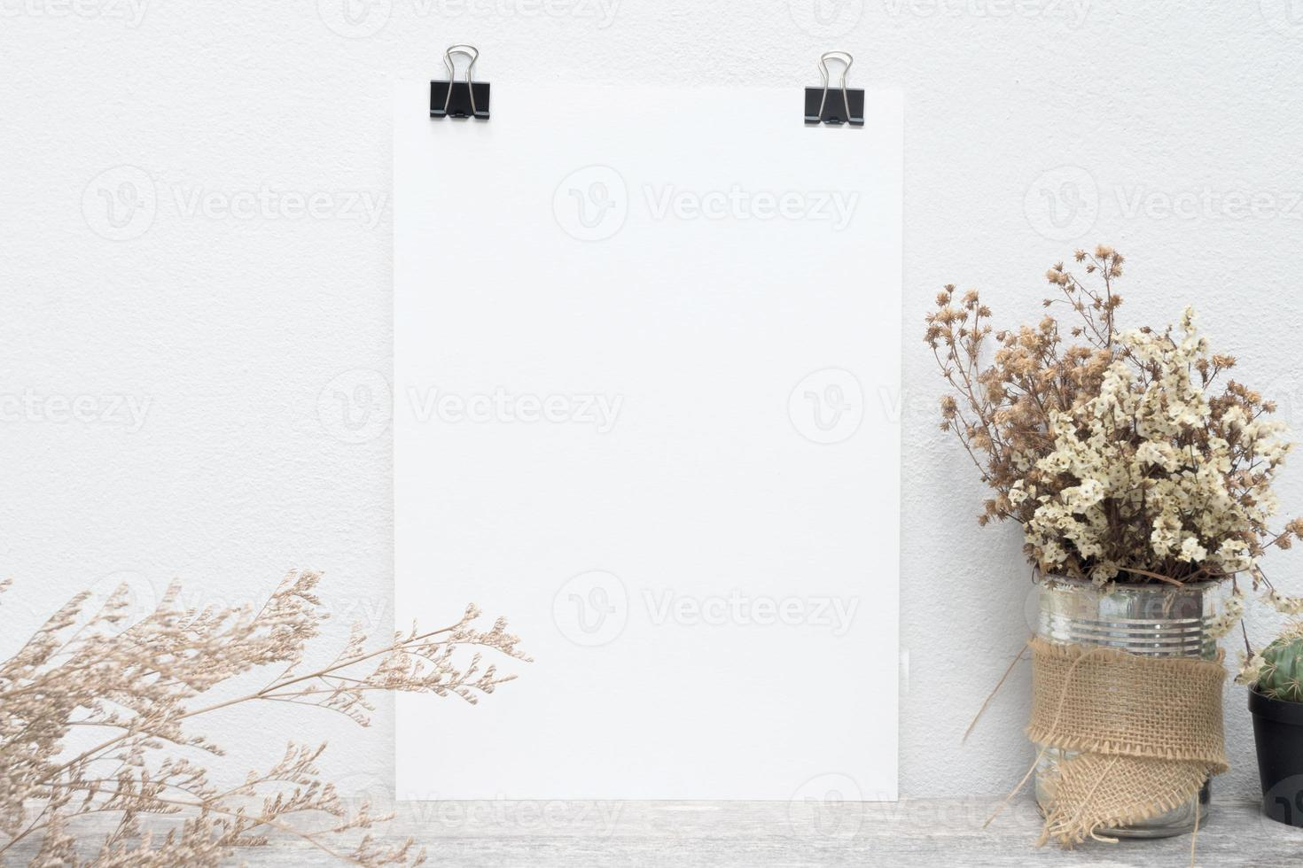 white poster on concrete background photo