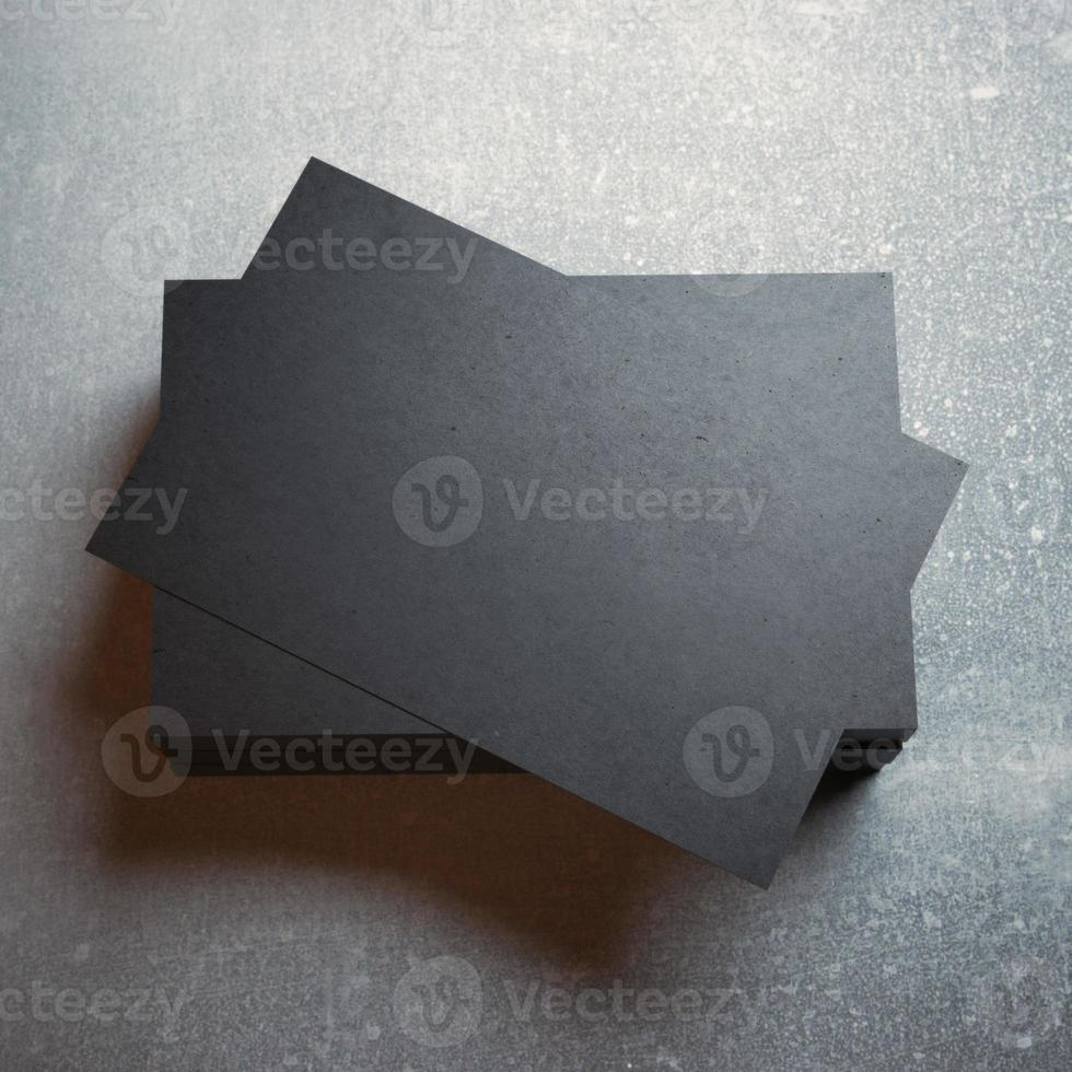 Black business cards on concrete photo