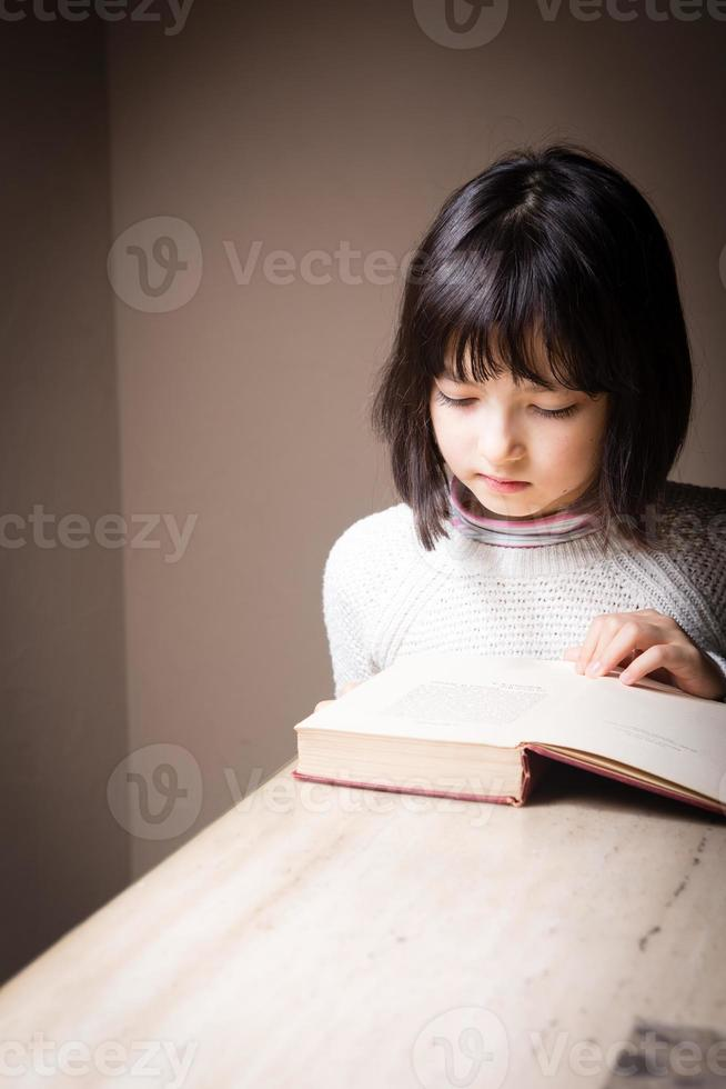 Girl reading studying book photo