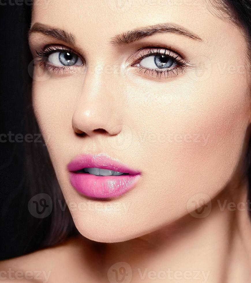 beautiful woman model with bright makeup and  pink lips photo