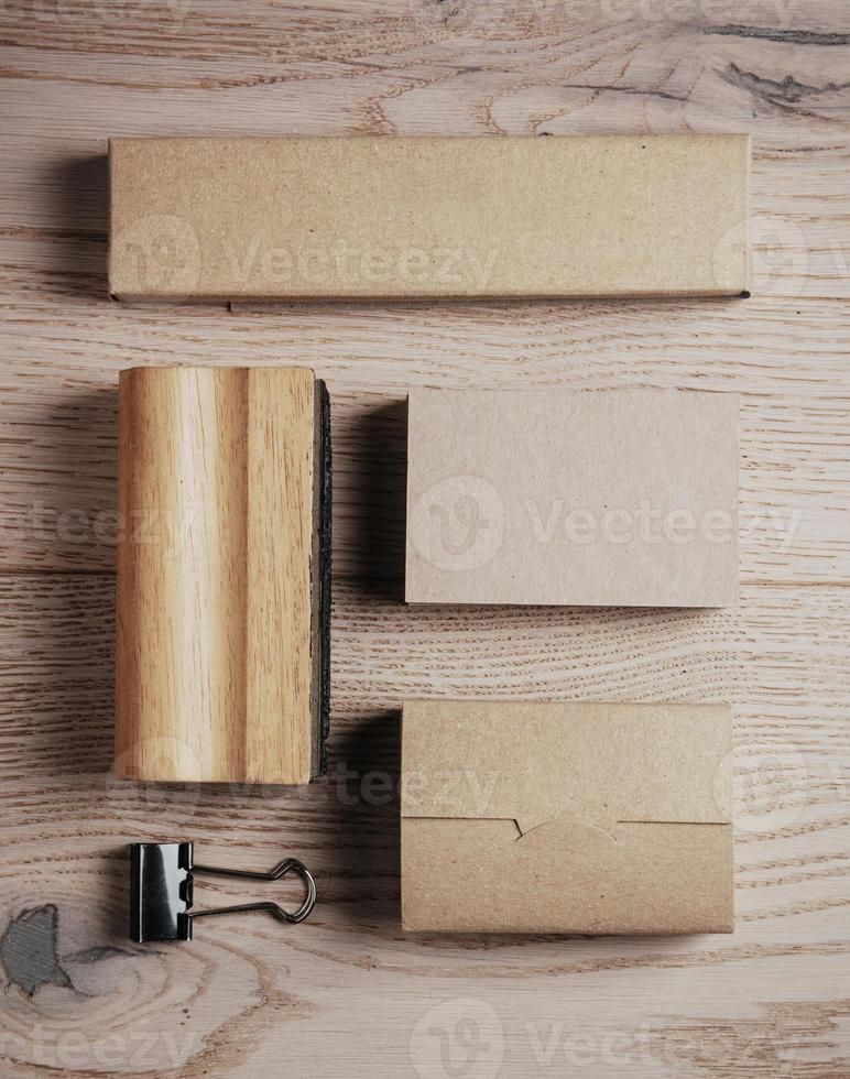 Set of blank classic office elements on the wooden background photo