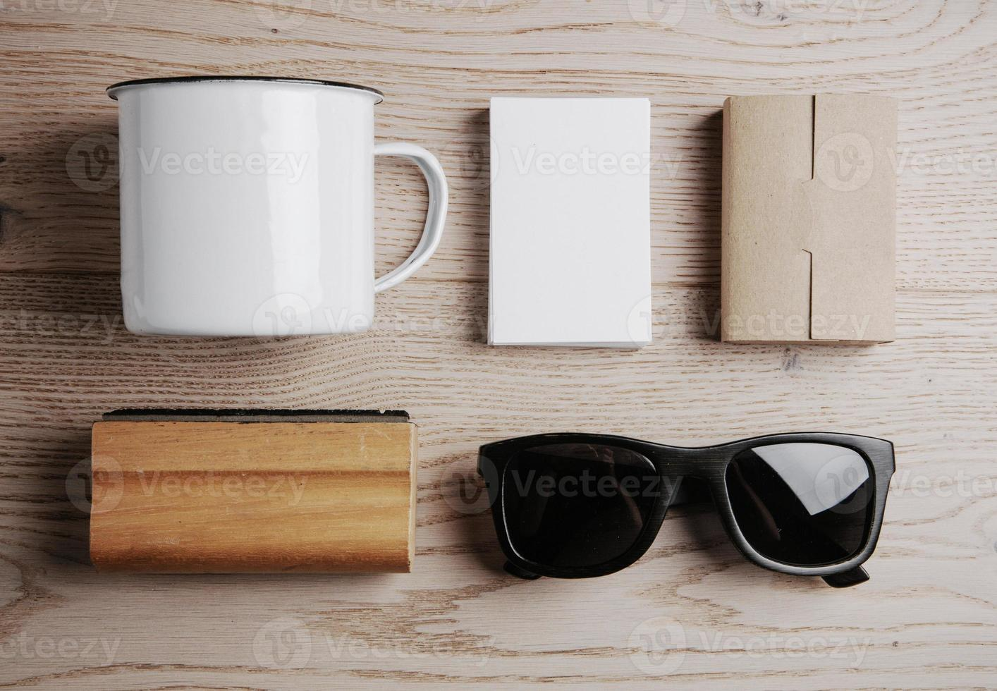 Top view of a office elements, sunglasses on the wooden photo