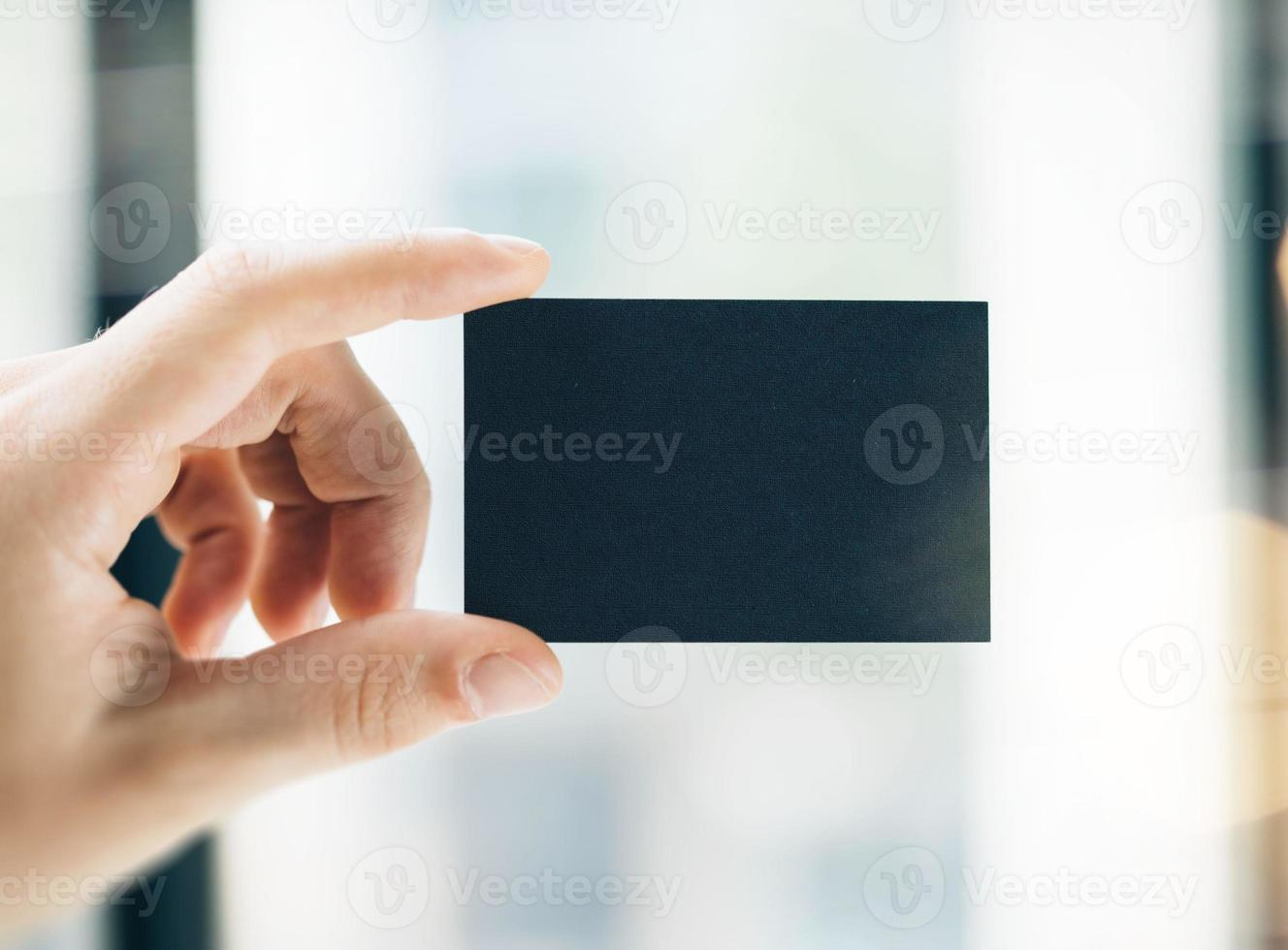business card on the blurred background photo