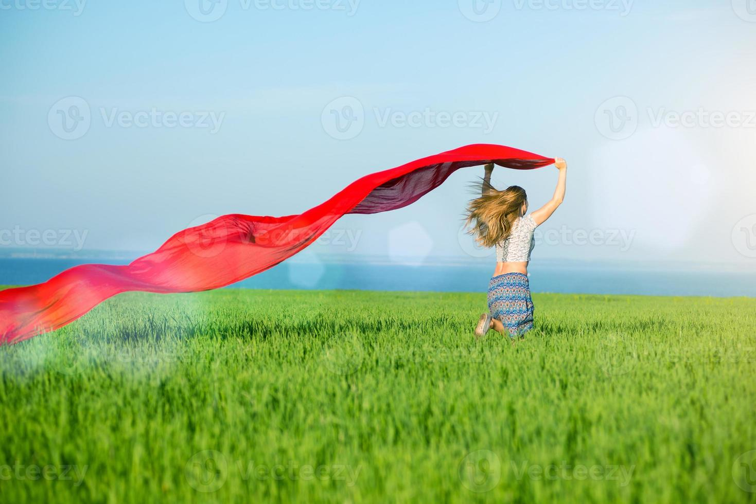 Young happy woman in wheat field with fabric. Summer lifestyle photo