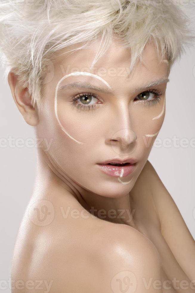 beautiful blond model wearing elegant artistic makeup photo